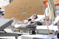 http://img263.imagevenue.com/loc16/th_312504796_Mischa_Barton_Bikini_Candids_on_the_Beach_in_Miami_December_27_2011_198_122_16lo.jpg