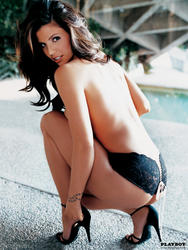 http://img263.imagevenue.com/loc443/th_006208443_charisma_carpenter_topless_playboy_shoot_03_123_443lo.jpg