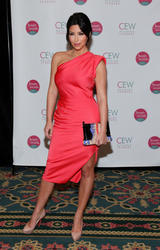 Kim Kardashian shows legs and her curvy body in sexy tight pinkish dress at Cosmetic Executive Women Beauty Awards in New York - Hot Celebs Home