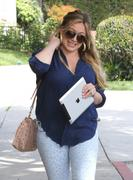 http://img263.imagevenue.com/loc565/th_129835923_Hilary_Duff_at_hair_salon_in_Beverly_Hills12_122_565lo.jpg